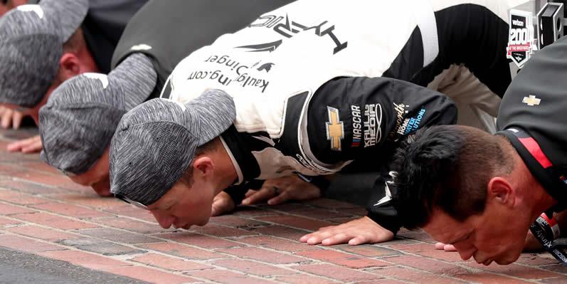 AJ Allmendinger and Matt Kaulig kissing the bricks