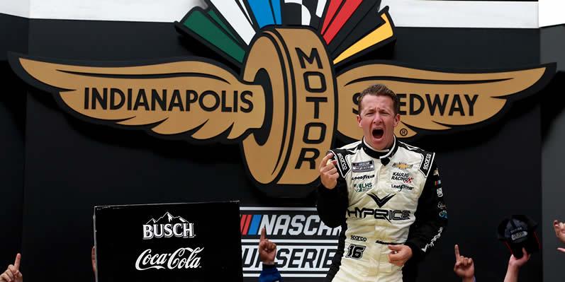 AJ Allmendinger celebrates in victory lane at Indianapolis Motor Speedway