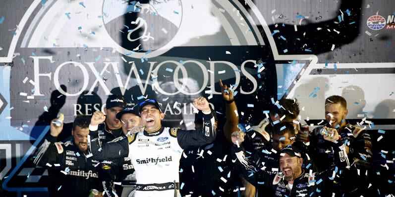 Aric Almirola celebrates in victory lane