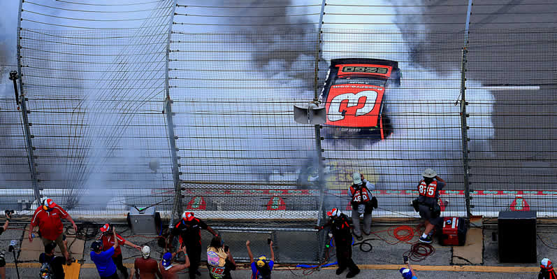 Austin Dillon celebrates with a burnout after winning the O'Reilly Auto Parts 500 at Texas Motor Speedway