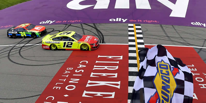 Ryan Blaney takes the checkered flag to win at Michigan International Speedway