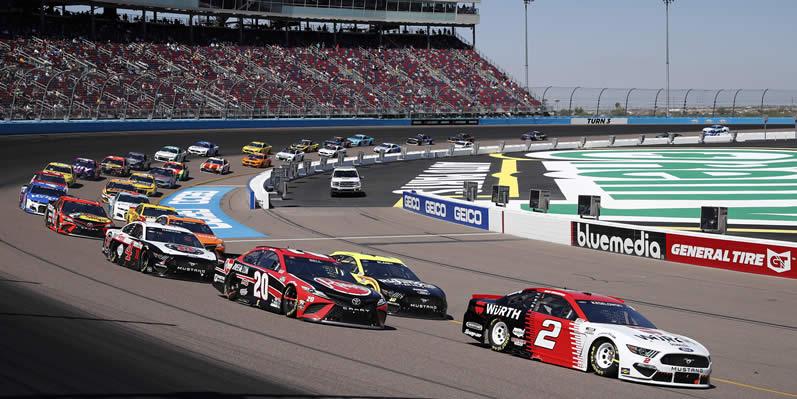 Brad Keselowski leads the field during the Instacart 500 at Phoenix Raceway