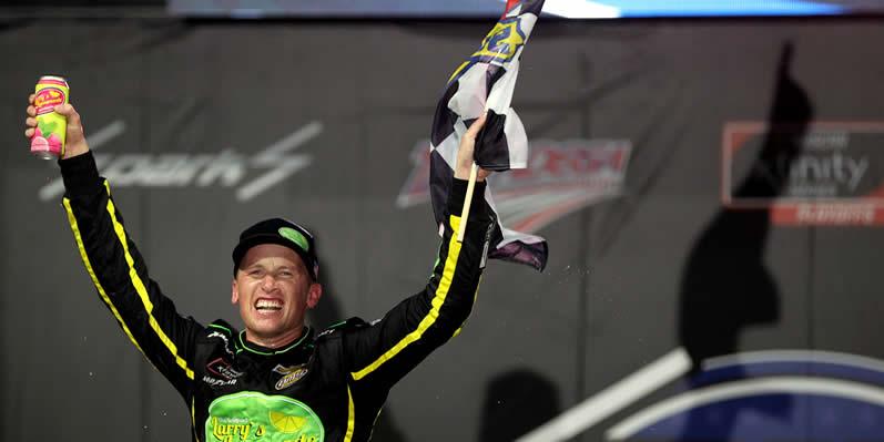 Brandon Brown celebrates in winning at Talladega Superspeedway