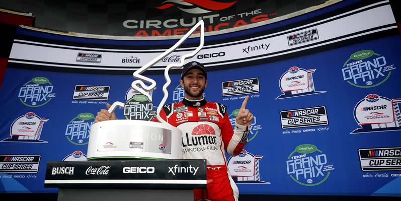 Chase Elliott celebrates in victory lane
