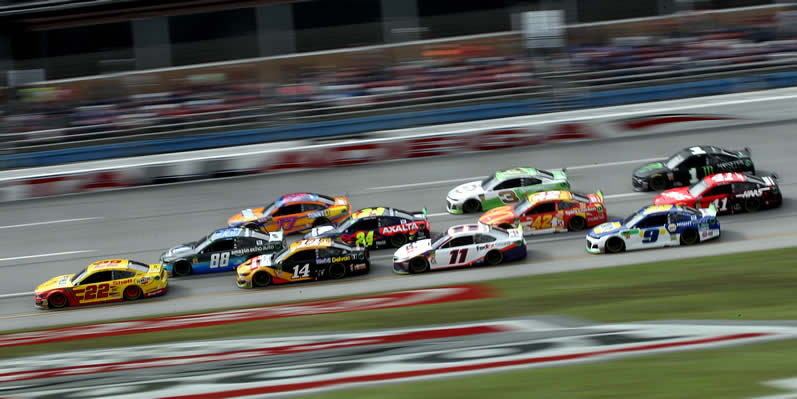 Joey Logano leads a pack