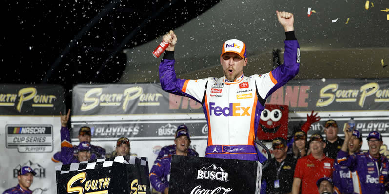 Denny Hamlin celebrates in victory lane at Las Vegas Motor Speedway