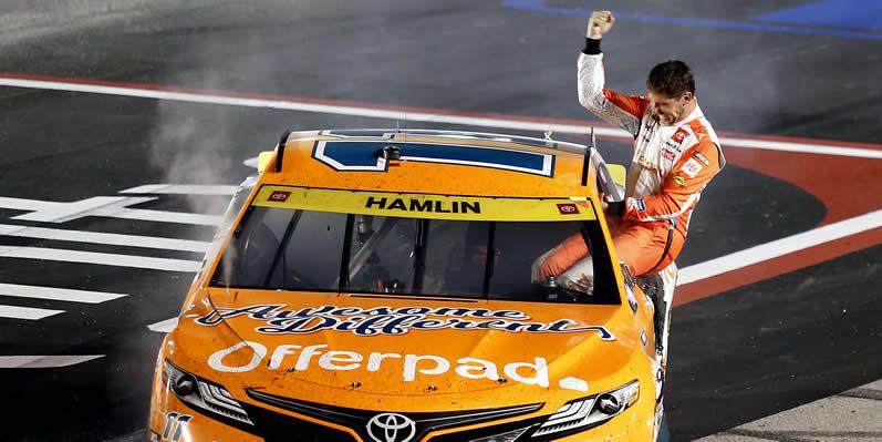Denny Hamlin celebrates after winning at Darlington Raceway