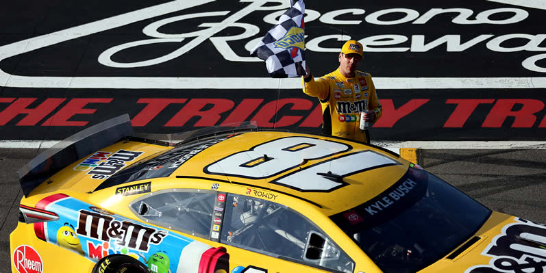 Kyle Busch celebrates with the checkered flag