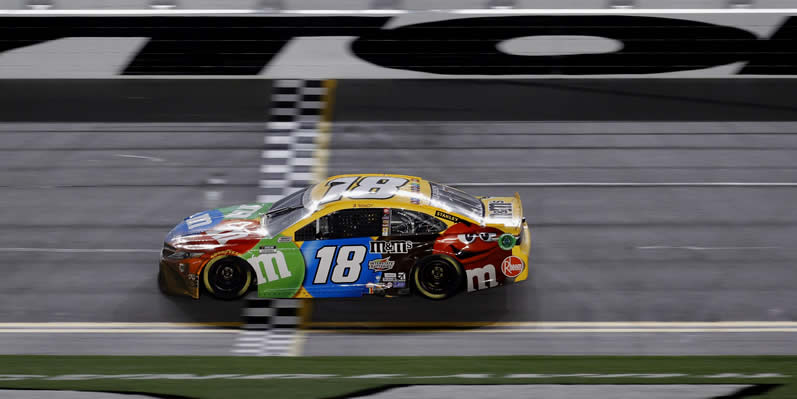 Kyle Busch crosses the finish line to win the NASCAR Cup Series Busch Clash