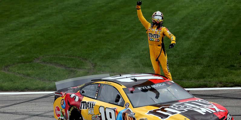 Kyle Busch celebrates after winning the Buschy McBusch Race 400