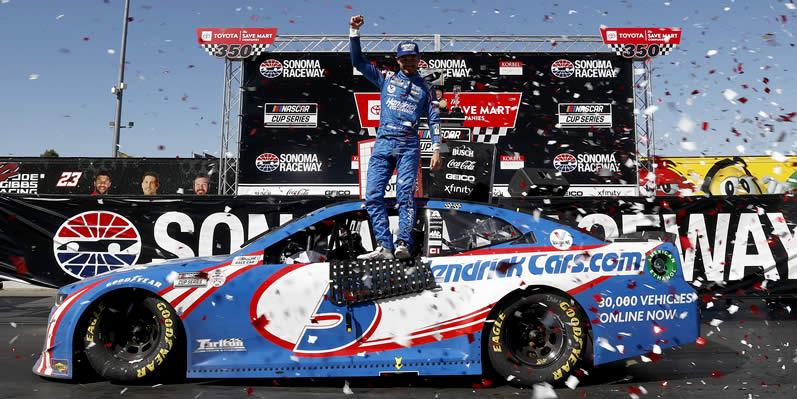 Kyle Larson celebrates in victory lane