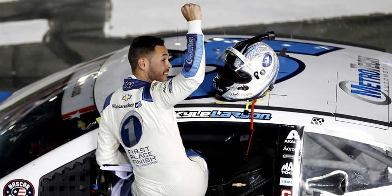 Kyle Larson celebrates after winning