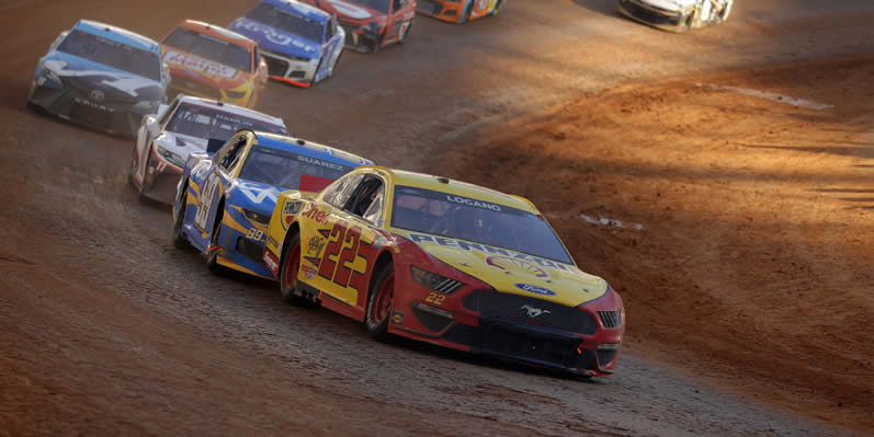 Joey Logano leads the field Food City Dirt Race
