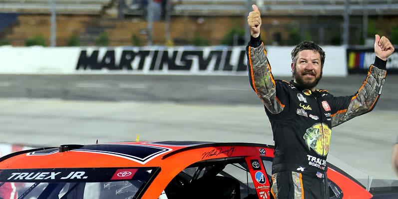 Martin Truex Jr celebrates winning at Martinsville Speedway