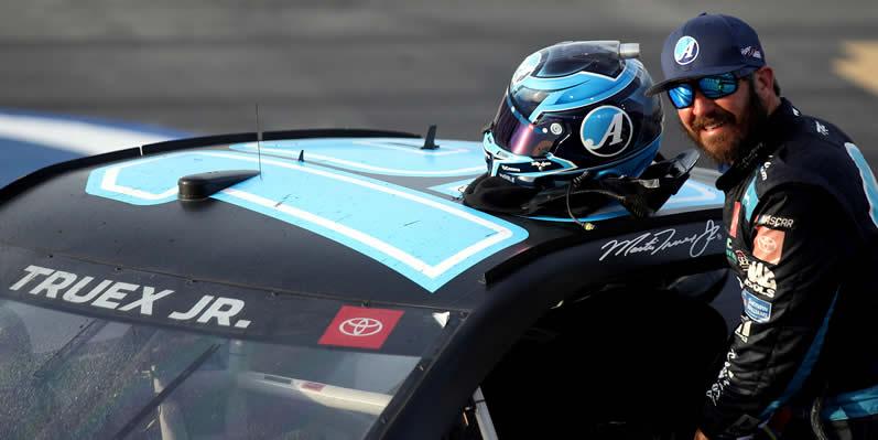 Martin Truex Jr exits his car