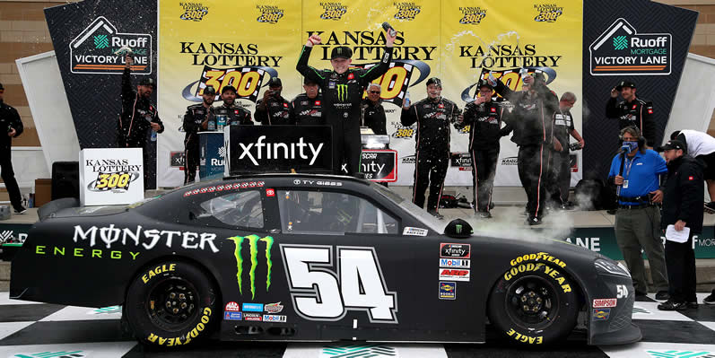 Ty Gibbs celebrates in victory lane at Kansas Speedway
