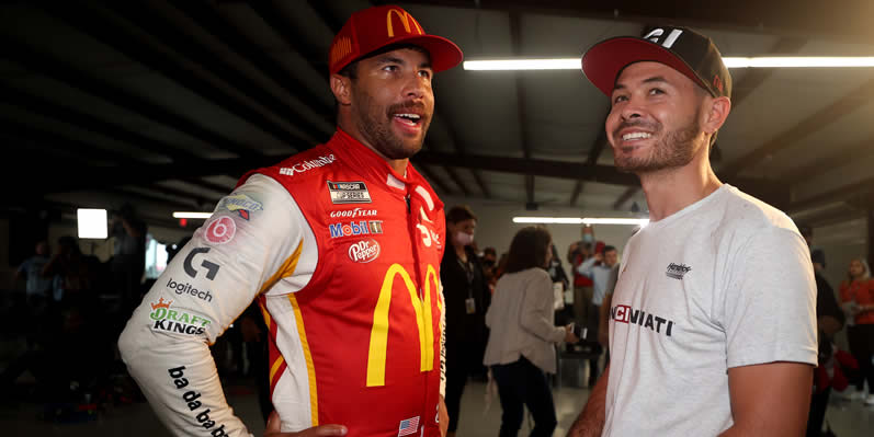 Bubba Wallace talks with Kyle Larson in victory lane at Talladega Superspeedway
