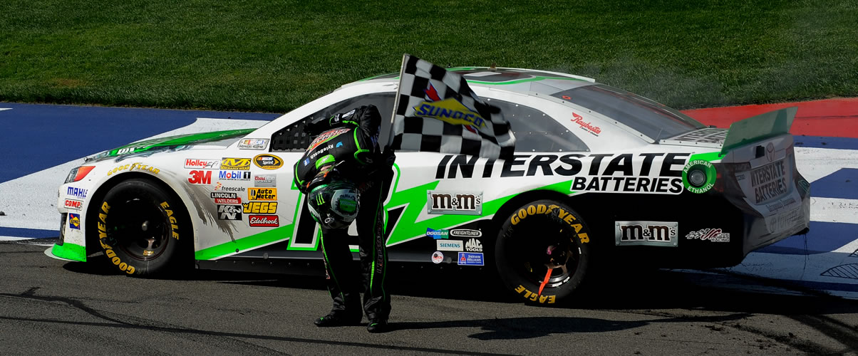 Kyle Busch bows in victory at Auto Club Speedway