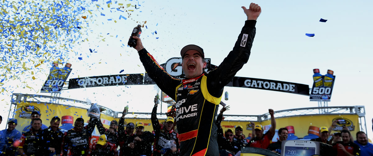 Jeff Gordon celebrates in victory lane at Martinsville Speedway