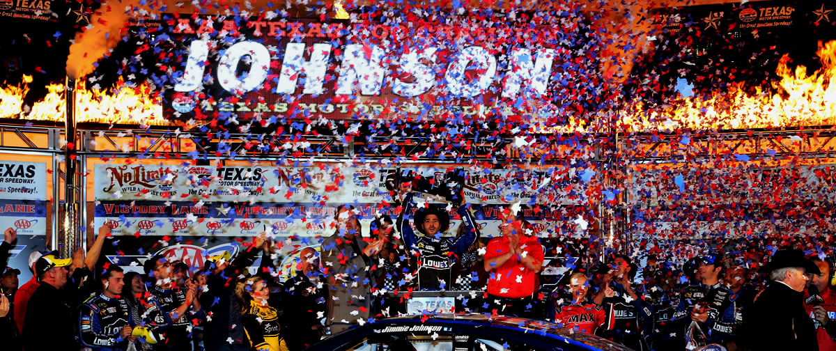 Jimmie Johnson celebrates in victory lane at Texas Motor Speedway